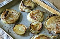 cooked cabbage steaks on a baking sheet