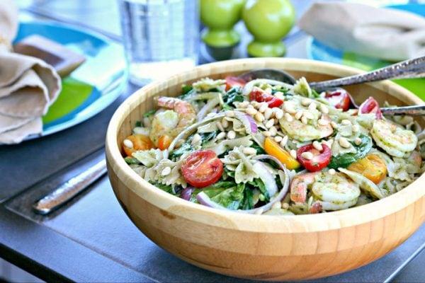 wood bowl with pesto pasta salad