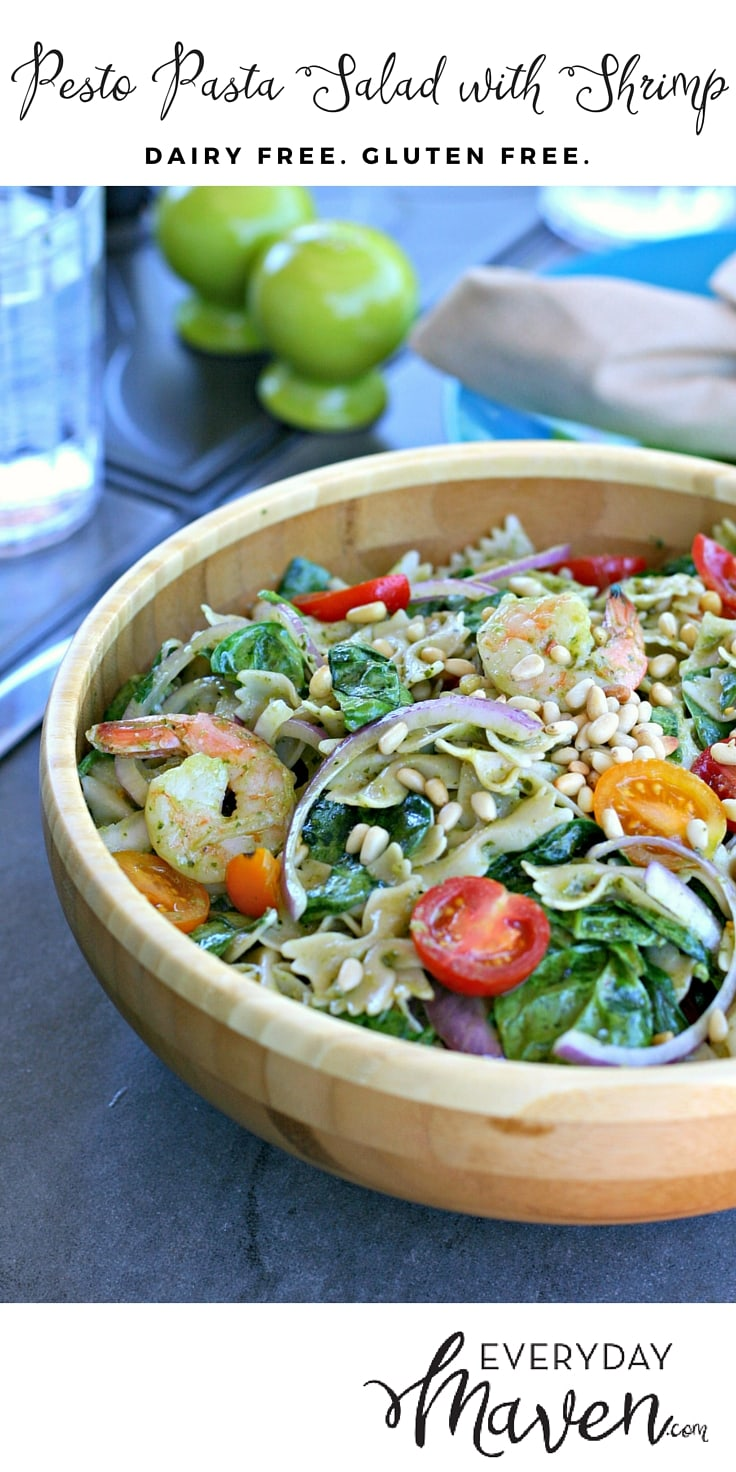 Gluten and Dairy Free Pesto Pasta Salad with Shrimp, Grape Tomatoes, Baby Spinach, Red Onion and Toasted Pine Nuts. A quick and delicious summer meal that is under 30 minutes!