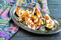 roasted acorn squash with tahini drizzle on a serving platter