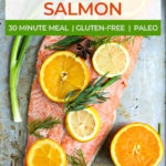poached salmon topped with sliced oranges, lemons and herbs