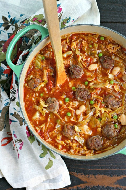 Italian Sausage Meatball Soup with Cabbage and White Beans from www.EverydayMaven.com