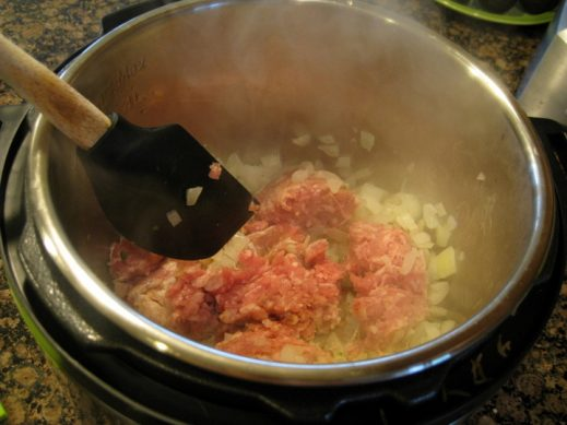 adding ground chicken to Instant Pot for Taco Soup from www.EverydayMaven.com