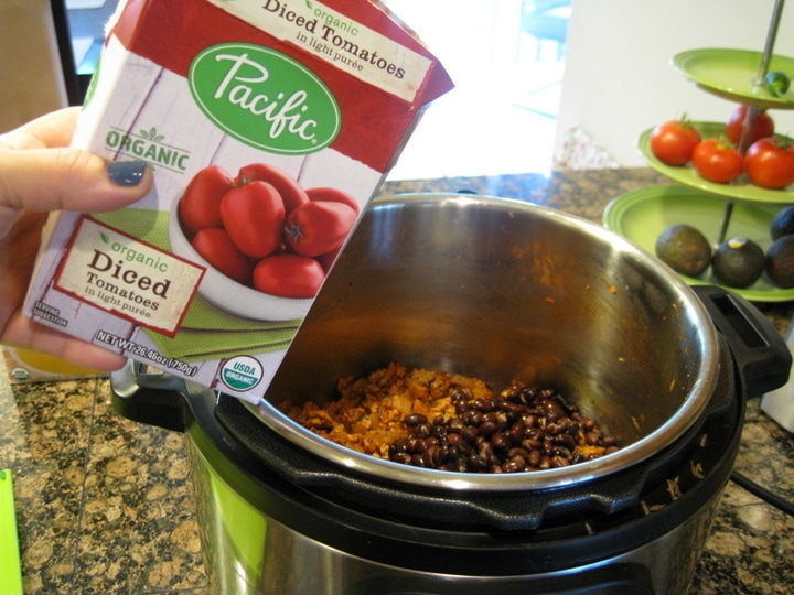Adding Pacific Foods Organic Diced Tomatoes to Taco Soup from www.EverydayMaven.com