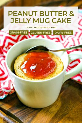 close up of peanut butter mug cake topped with strawberry jelly