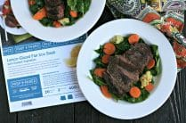 photo of Flat Iron Steak and Vegetable Dinner with napkin and recipe card on table