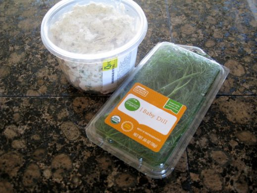 container of chicken salad and fresh dill