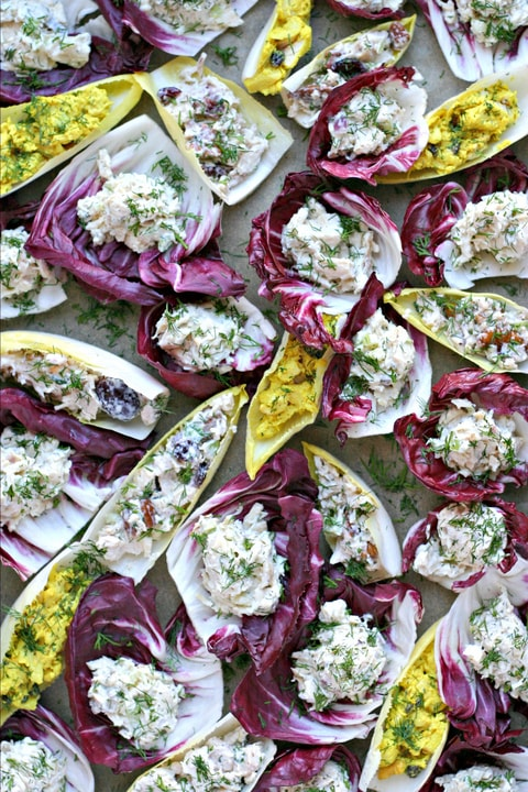 a tray of chicken salad stuffed into radicchio and endive cups
