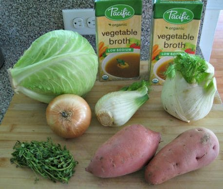 ingredients to make Roasted Vegetable Soup on a wood cutting board