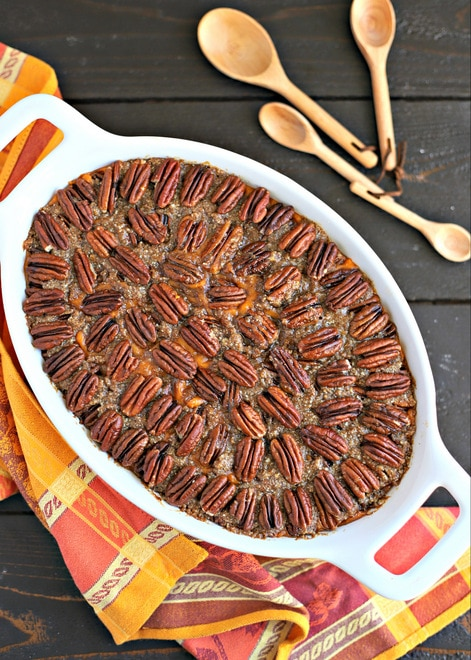 overhead shot of white casserole dish with pecan topped healthy sweet potato casserole