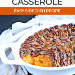 healthy sweet potato casserole topped with pecans in a white serving dish