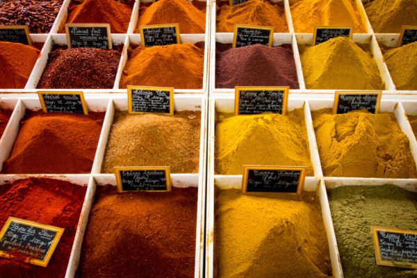 bins of different colored spices