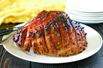 maple glazed smoked ham on a large serving platter