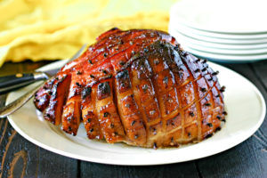 maple glazed smoked ham on a large serving platter
