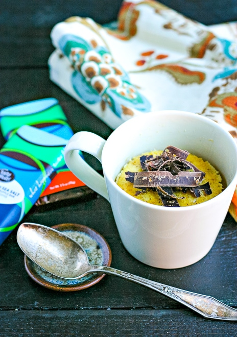 microwave cake topped with shaved chocolate and silver spoon