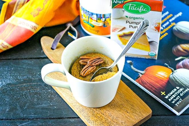 paleo mug cake made with pumpkin topped with pecans