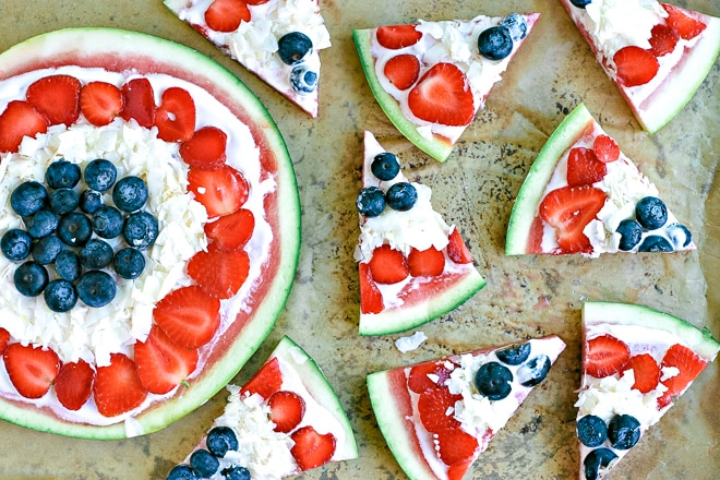 watermelon pizza slices topped with non-dairy yogurt, coconut and fresh berries