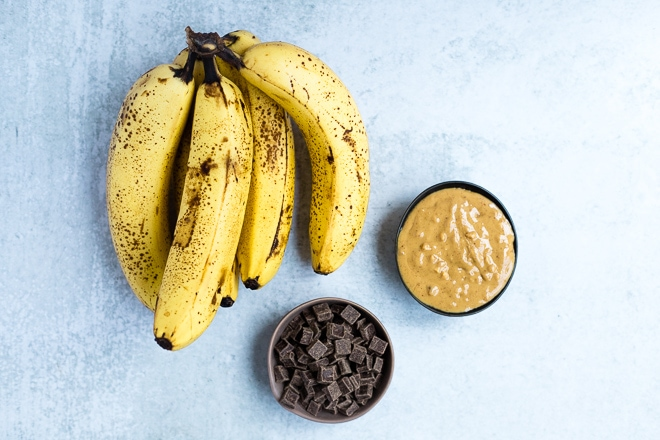 ripe bananas, nut butter and chocolate chips in a bowl to make baked bananas