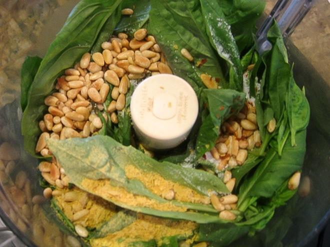 making vegan pesto in the food processor