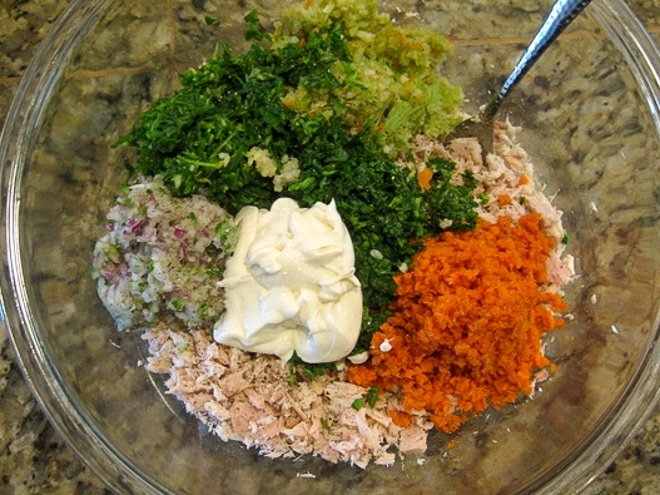 clear mixing bowl with ingredients to make tuna salad