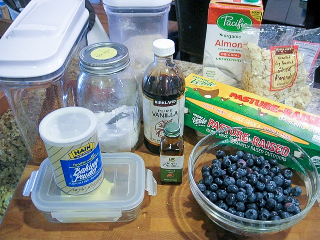 ingredients to make blueberry clafoutis on a cutting board