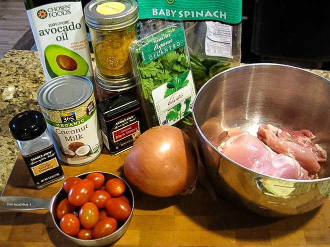 ingredients to make paprika chicken on a cutting board
