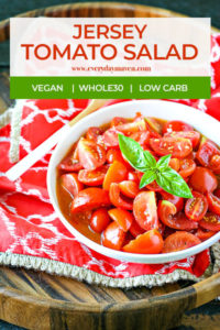 bowl of tomato salad topped with basil using jersey tomatoes