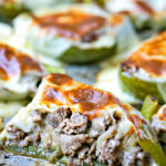 close up of cooked philly cheesesteak stuffed pepper on a tray