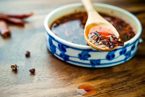 blue and white dish filled with homemade chinese chili oil