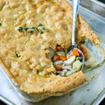 close up of cooked paleo chicken pot pie with serving spoon scooping some out