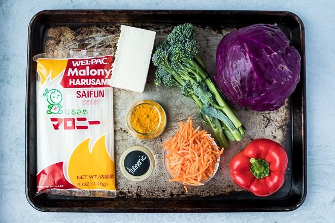 ingredients on a baking sheet to make vegan noodle bowls