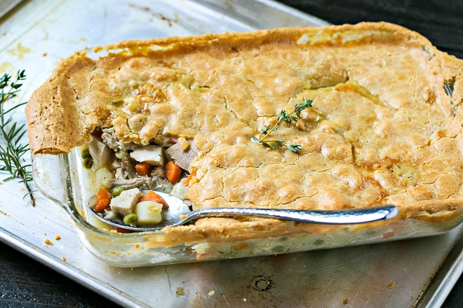 large casserole dish of gluten-free chicken pot pie with serving spoon