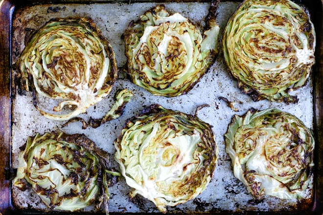 baking sheet with roasted cabbage steaks