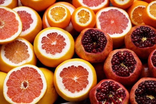 sliced citrus and pomegranates