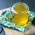 small jar of liquid ghee cooling