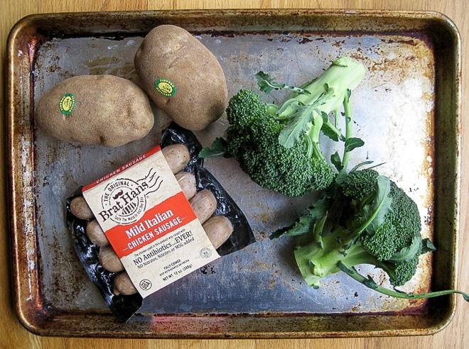 uncooked ingredients to make sausage sheet pan dinner