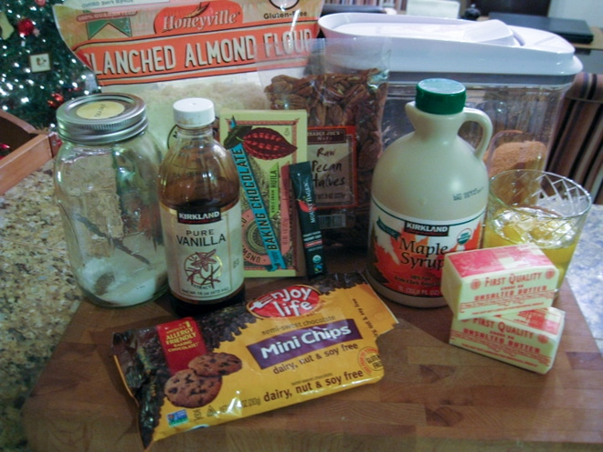 ingredients to make pecan brownies on a wood cutting board
