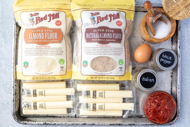 tray with ingredients to make gluten-free mozzarella sticks