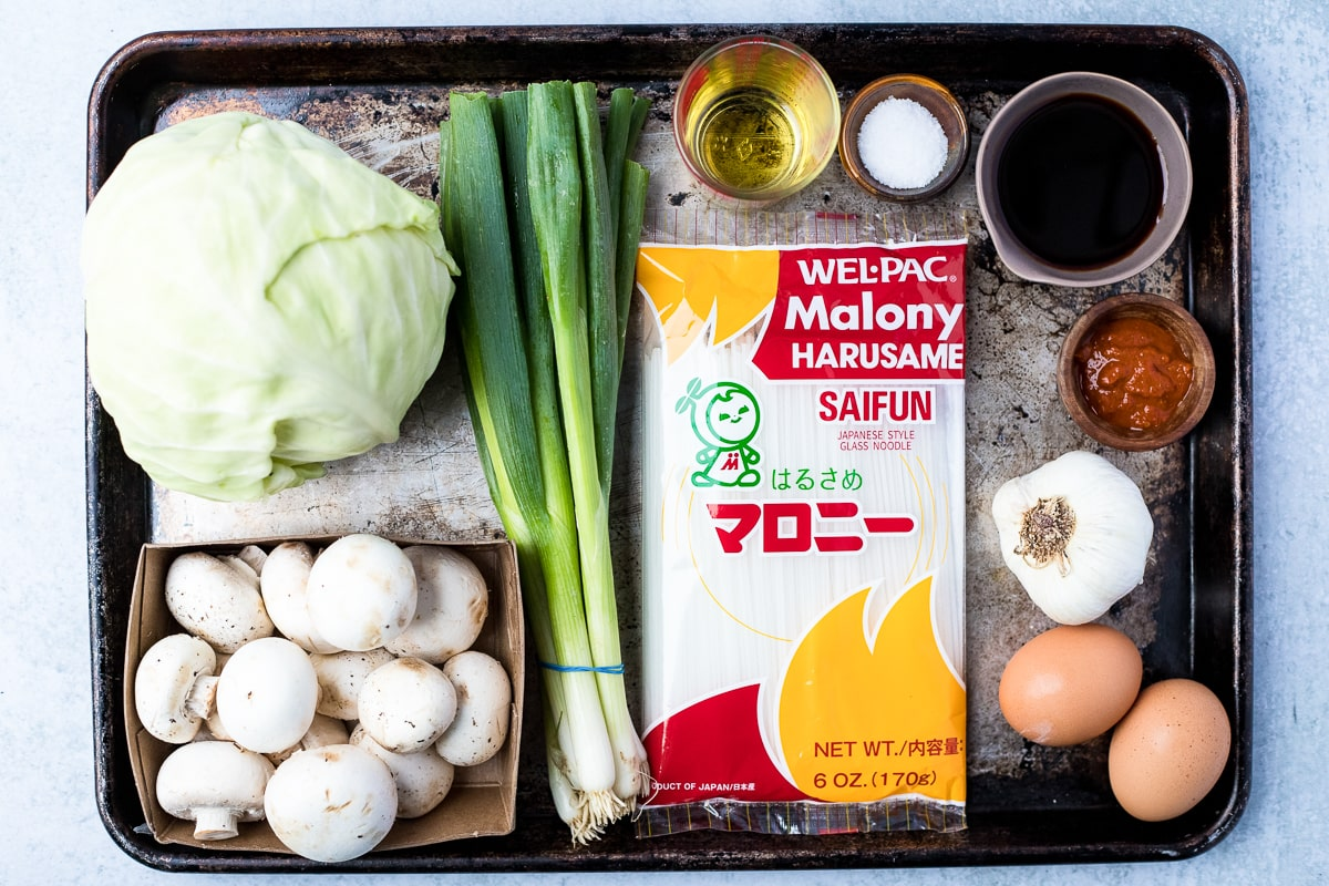 ingredients on a baking sheet for glass noodle stir fry