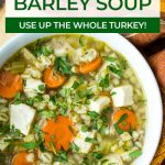 close up of turkey barley soup in a bowl with text for pinterest