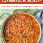 pot of cabbage and sausage soup with text for pinterest