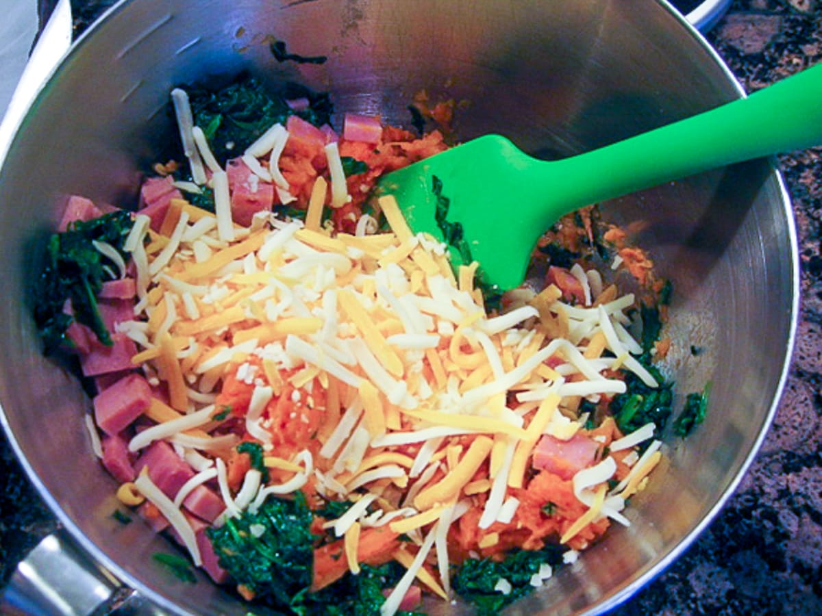 mixing chopped ham, spinach and cheese in a mixing bowl