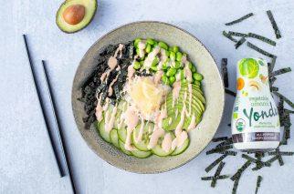 grey bowl with cooked sushi roll ingredients next to bottle of yondu seasoning and black chopsticks