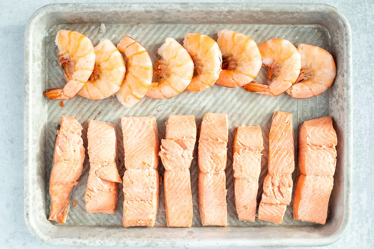 small baking sheet with cooked salmon and shrimp