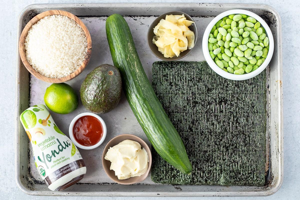 baking sheet with ingredients to make deconstructed vegan sushi bowls