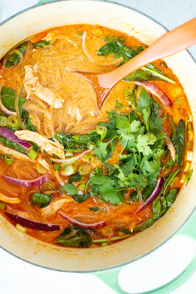 close up of red curry soup with glass noodles