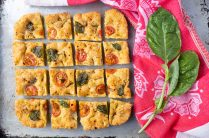 squares of grain free focaccia with fresh basil