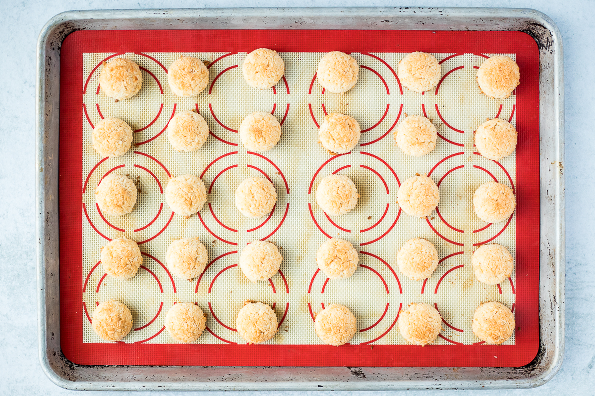 baked mini coconut macaroons on a baking sheet