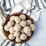 close up of nut free energy balls in a wood bowl