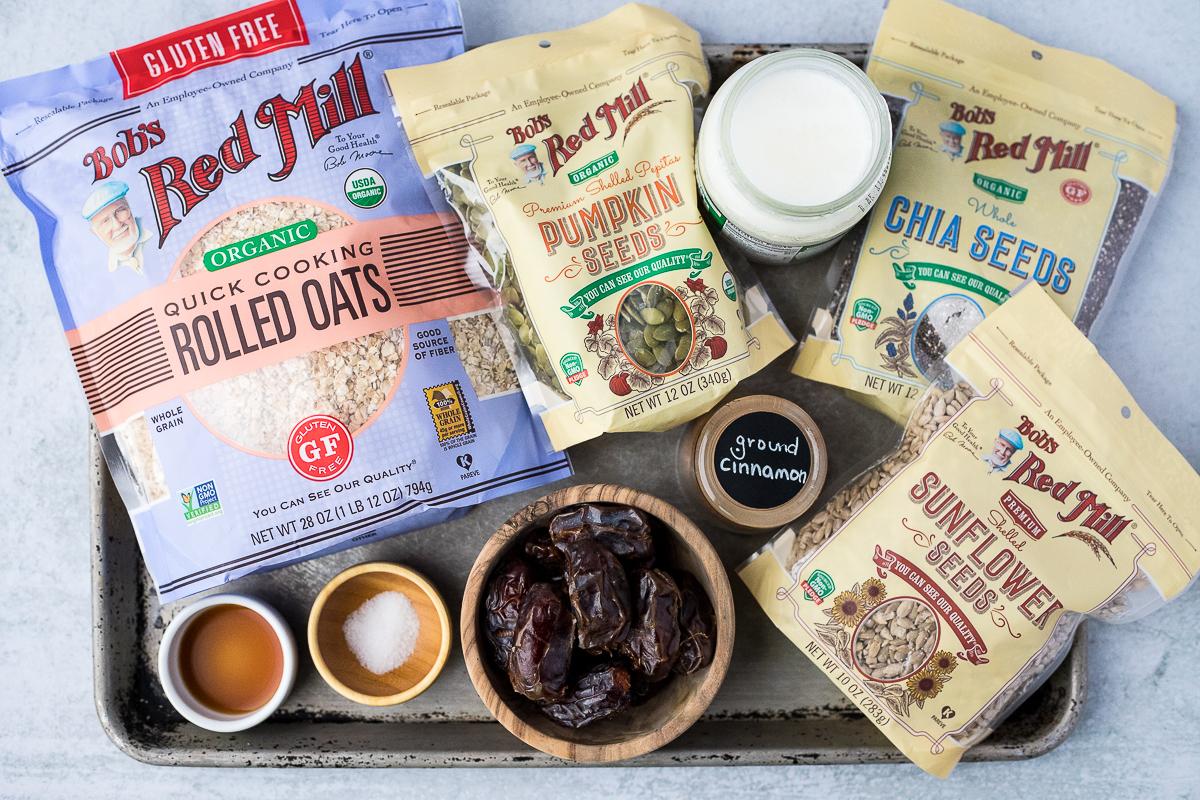 baking sheet with ingredients to make nut free energy balls